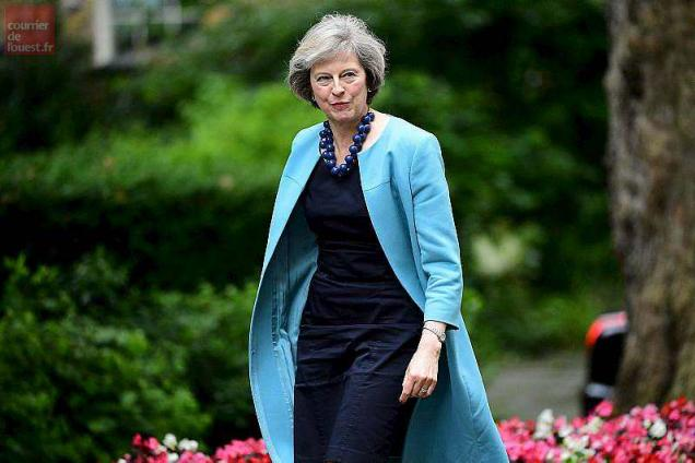 """(FILES) This file photo taken on June 27, 2016 shows British Home Secretary Theresa May walking in Downing Street to attend a cabinet meeting at 10 Downing Street in central London. Theresa May became the sole contender to become Britain's next prime minister on Monday after her sole rival pulled out in a dramatic twist as turmoil sweeps the political scene in the wake of the Brexit vote. Andrea Leadsom, who had come in for heavy criticism after appearing to imply that she was more qualified than May because she had children, said a lengthy leadership race would be """"highly undesirable"""". / AFP / LEON NEAL"""