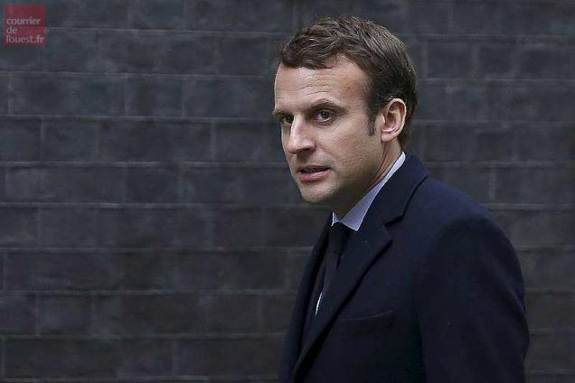 """(FILES) This file photo taken on February 21, 2017 shows French presidential election candidate for the En Marche ! movement Emmanuel Macron, arriving outside 10 Downing Street in central London, ahead of his meeting with British Prime Minister Theresa May. Incoming French President Emmanuel Macron will hold a """"tough"""" line during Brexit negotiations but will not seek to """"punish"""" Britain, his chief economic adviser said on May 8, 2017. Macron, who campaigned on a pro-EU platform, has previously called Brexit a """"crime"""" and said that Britain should continue paying into the EU budget if it wants access to the European single market. / AFP / Daniel LEAL-OLIVAS"""